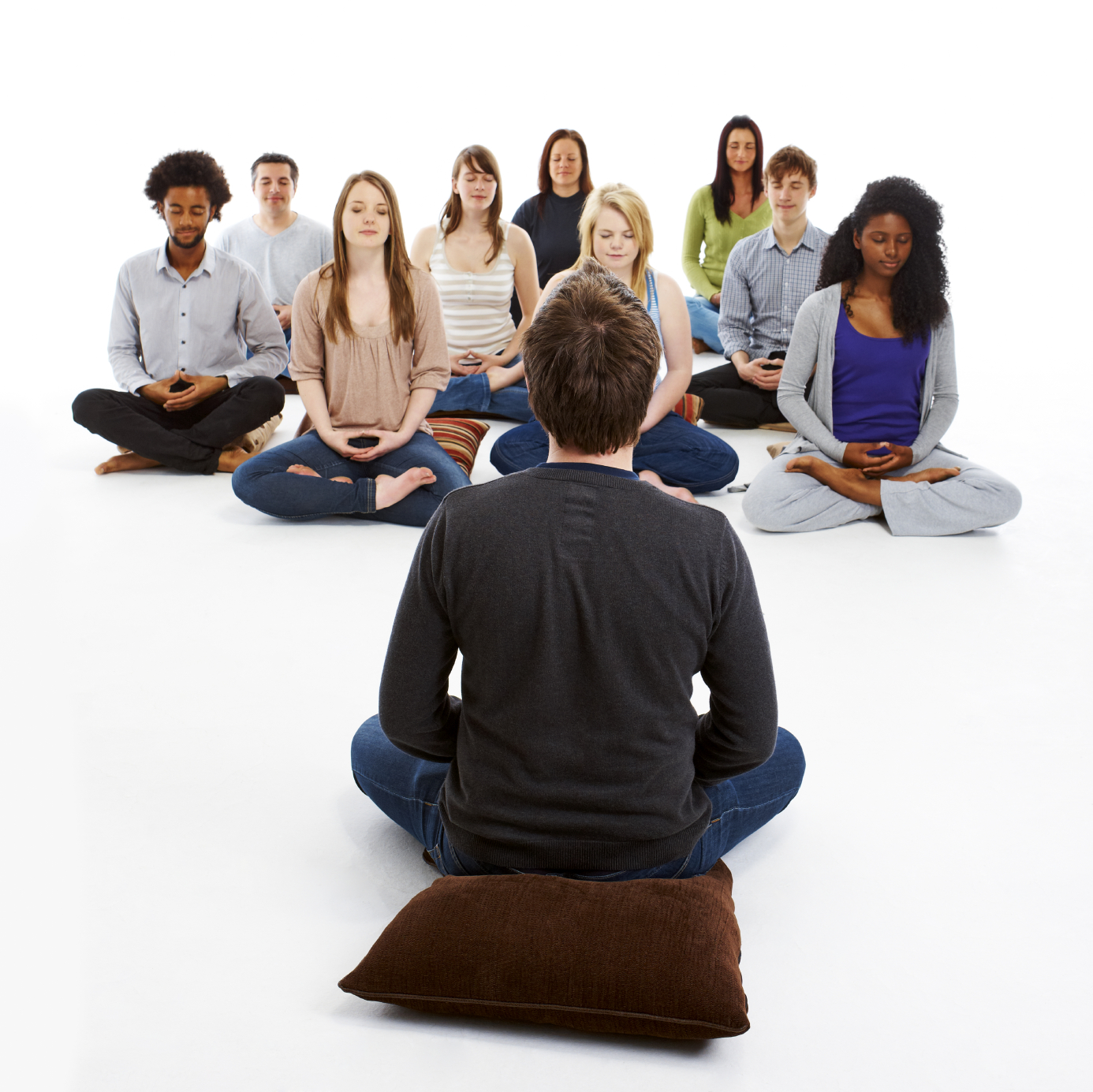 meditation teacher meditating with a group of people isolated on white